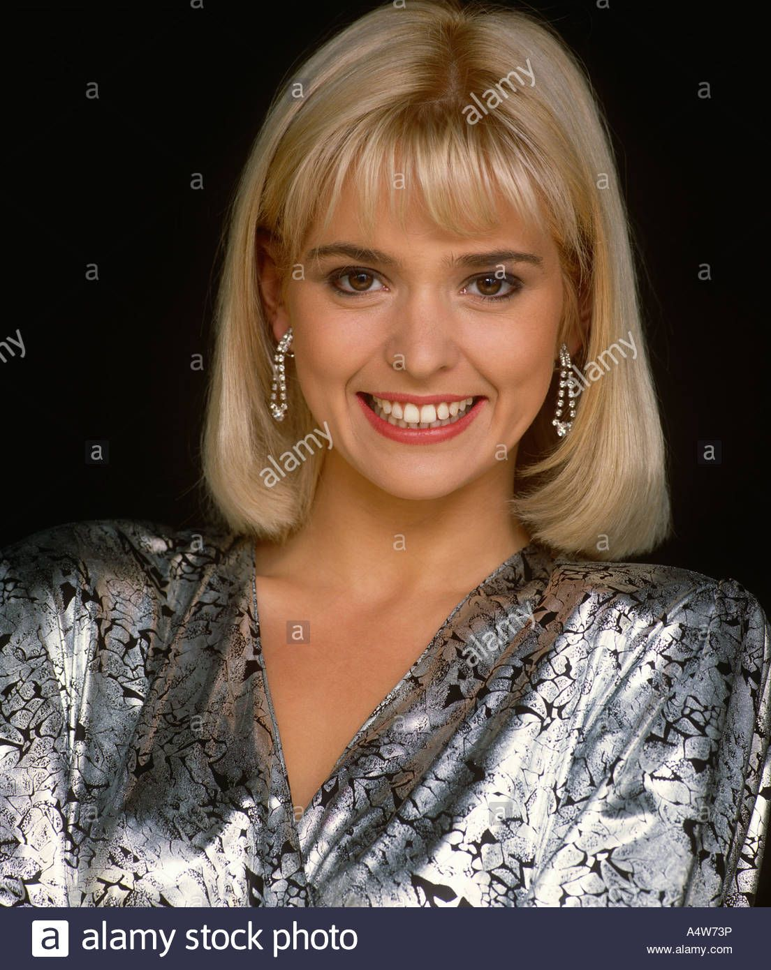 JOANNE GUEST IN SILVER AND BLACK WRAP TOP Stock Photo