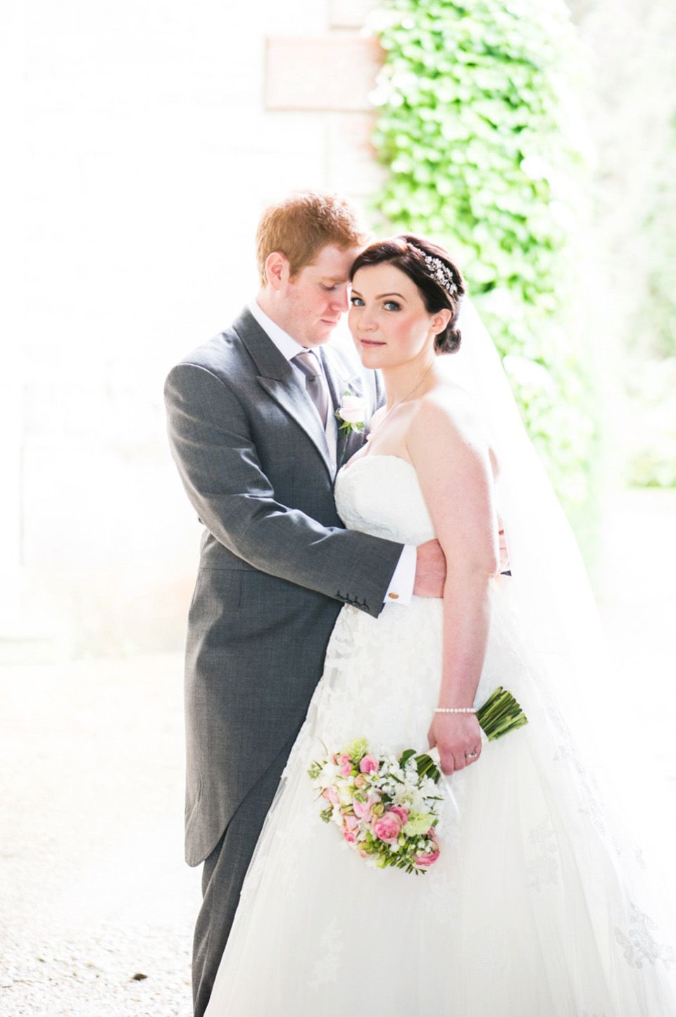 Pretty pink peonies and pronovias for a traditional english wedding