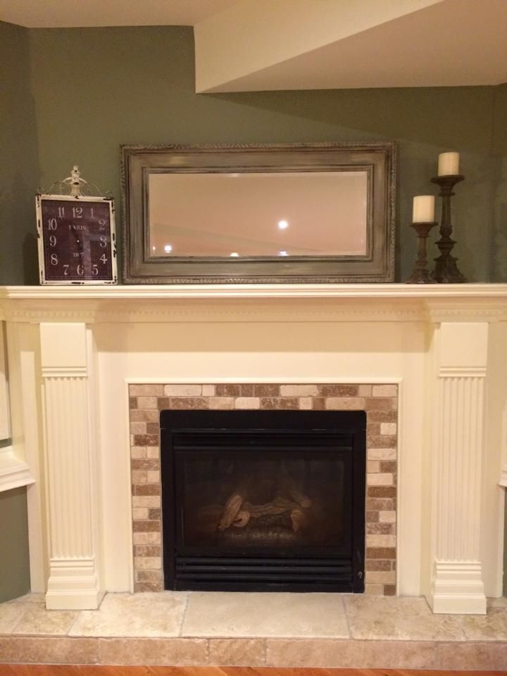 Southern charm design restyled clients fireplace and mirror....