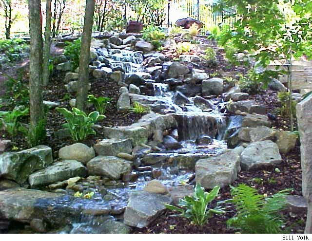Pondless waterfall feature completely shaded and natural for Natural backyard pond