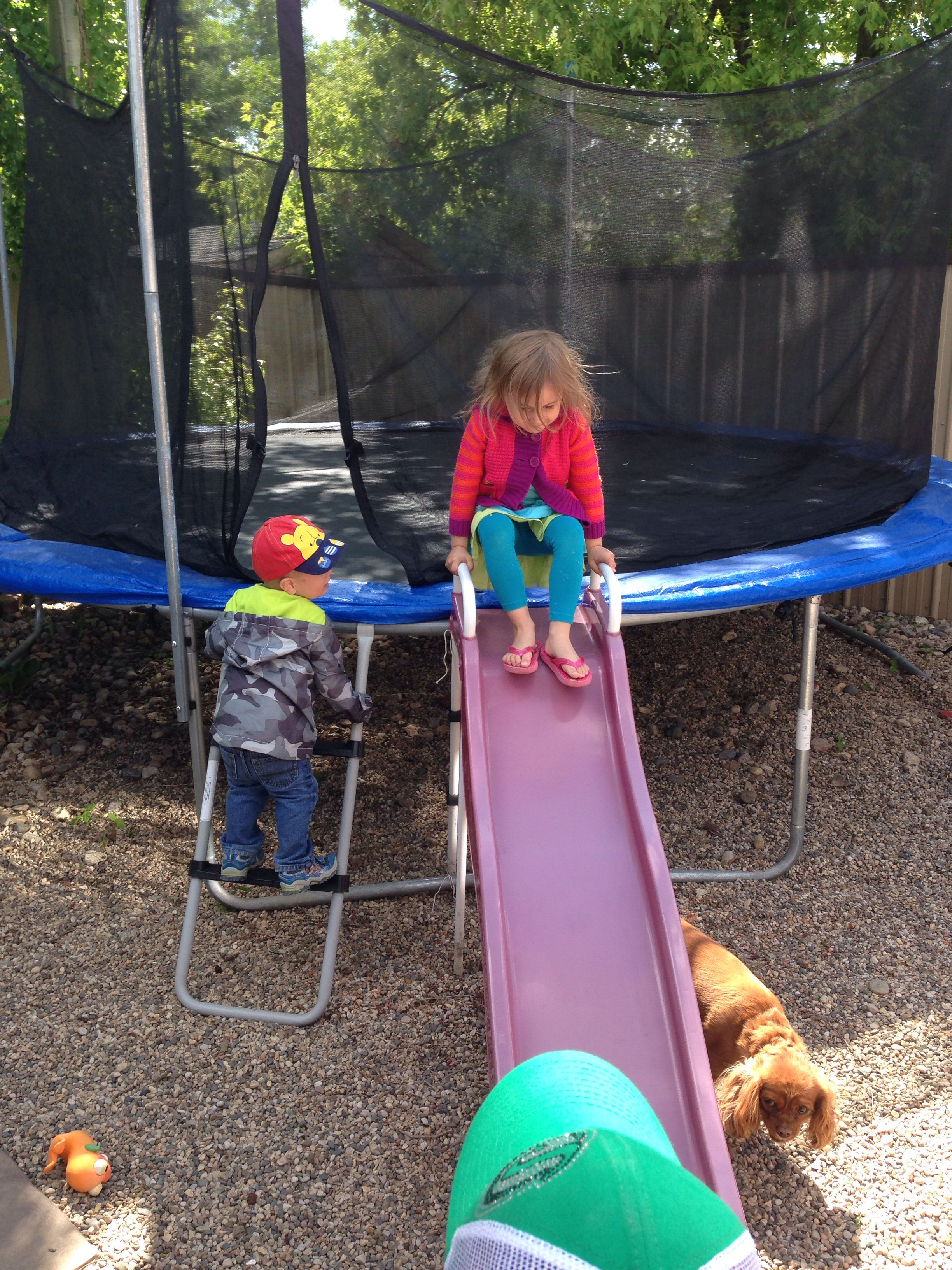Attach a slide to trampoline so it's easier for little