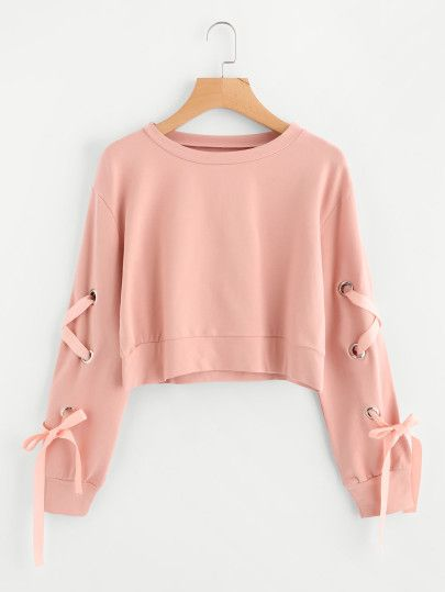 cf304531ce Shop Eyelet Lace Up Sleeve Crop Sweatshirt online. SheIn offers Eyelet Lace  Up Sleeve Crop Sweatshirt   more to fit your fashionable needs.