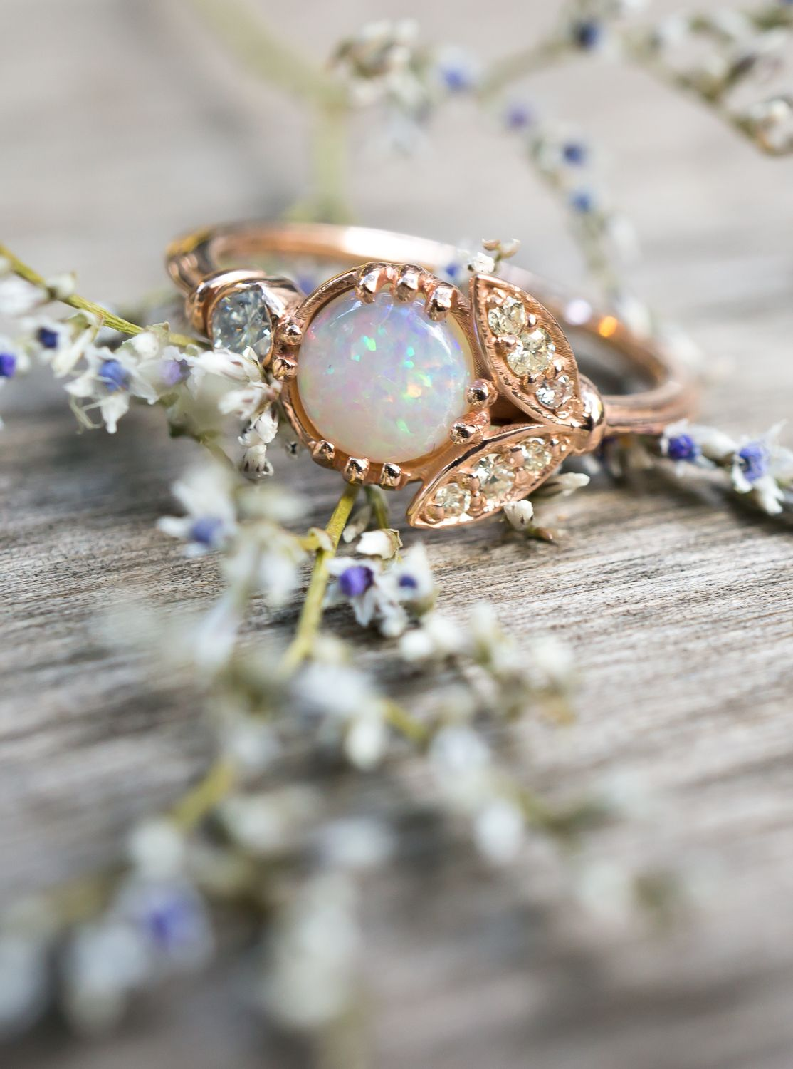 Antique inspired opal engagement ring with vintage diamonds