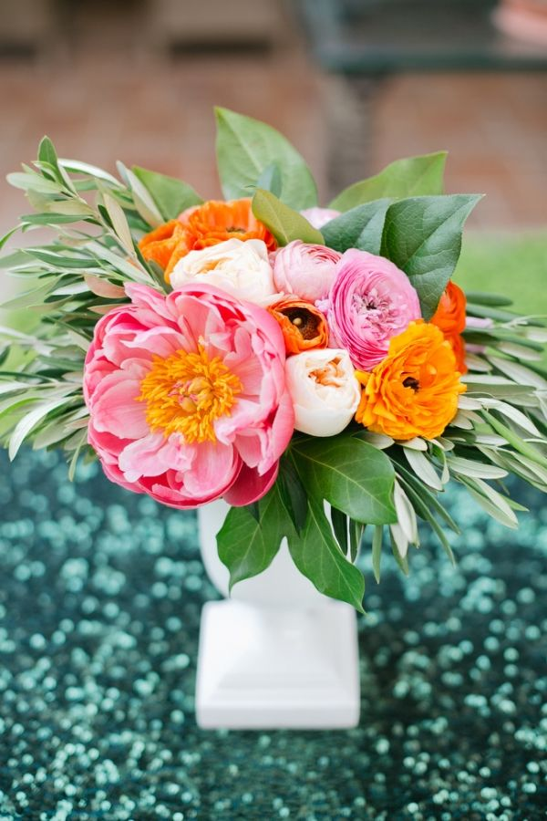 Bold colors and modern sparkle in palm springs bold bright wedding peony and ranunculus centerpiece on sequin linens onelove photography bold colors and modern sparkle in palm springs for a glam desert wedding mightylinksfo