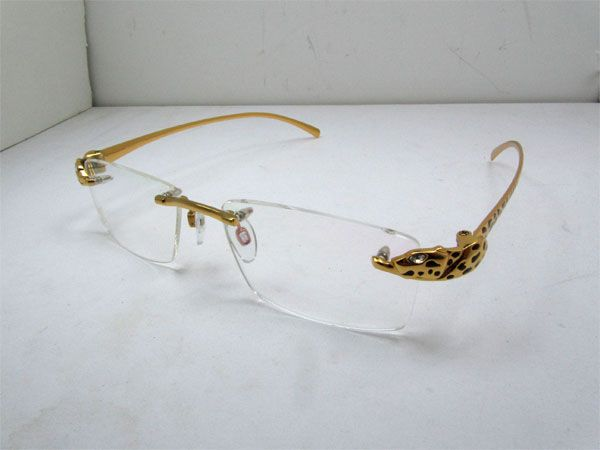 6fd701524951f 2011 LIMITED Cartier Panther 8200876 Titanium Eyeglasses In Gold ...