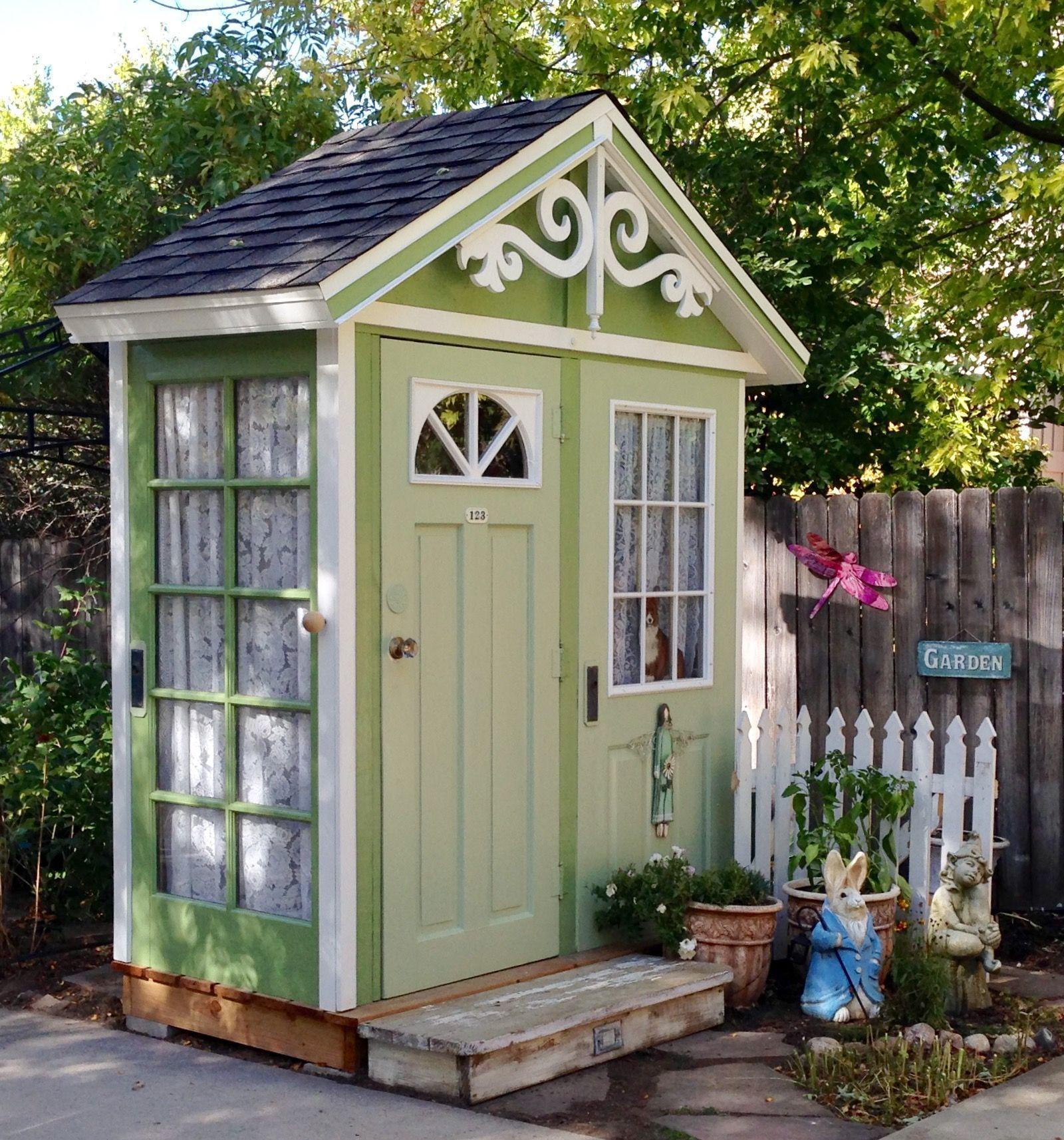 my garden shed. my husband built this out of old doors. i love it