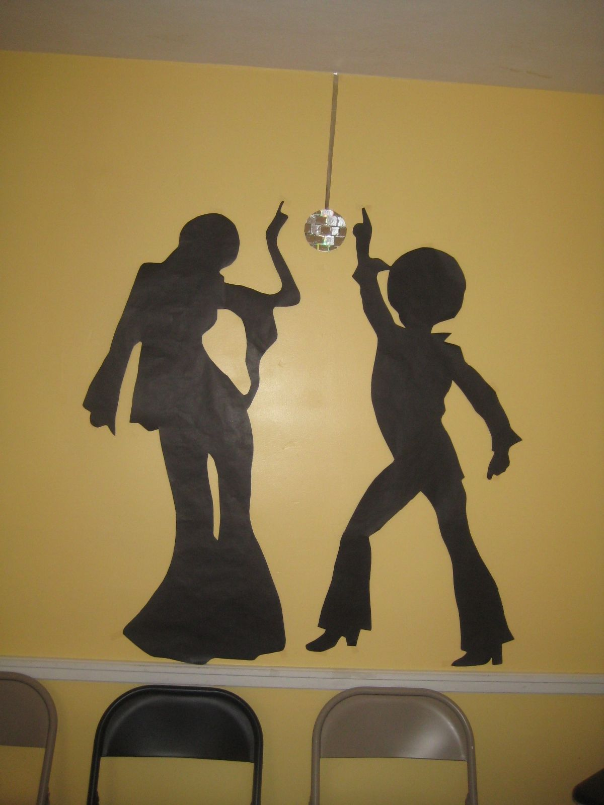Disco dancer silhouettes-projected on a wall and traced on black ...
