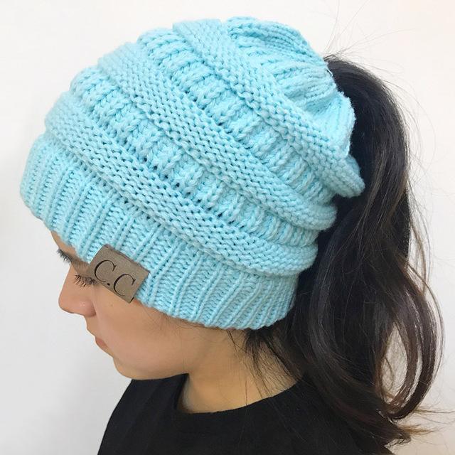 2018 CC Warm Winter Hat For Women Ponytail Beanie Stretch Cable Knit Messy  Bun Hats Soft Ski Cap Wholesale  HatsForWomen2018 68b973061ac