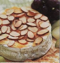 """Simply French: Baked Brie with Almonds I used 2 tablespoons of softened butter and spread it over the Brie and covered it in sliced almonds ... Lets just say """"divine"""""""