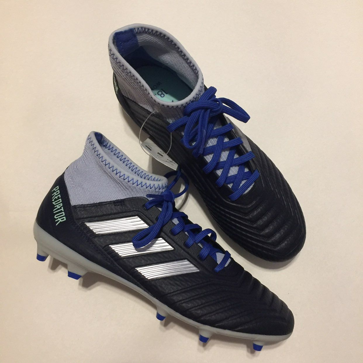 Brand new without box silver and blue adidas cleats