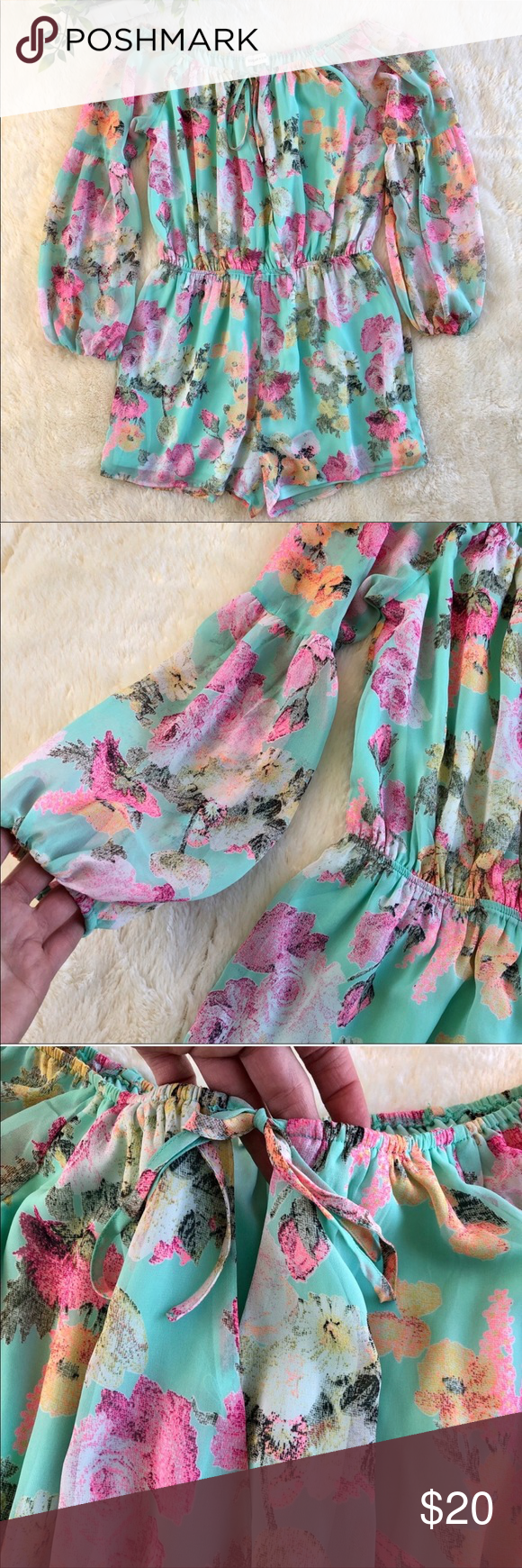 Sugar lips blue pink floral romper belle sleeves Sugar lips blue pink floral shirts romper with belle sleeves.I absolutely love this romper! I bought it and took it on a cruise with me but the shorts are just too short for my taste. I love the bright colors and print.it is very flattering with the sheer bell sleeves and the off the shoulder design.the sleeves are sheer.has an elastic waist and A keyhole neckline with a drawstring. I typically wear a size 10 so this would fit a size 8/10perfectly