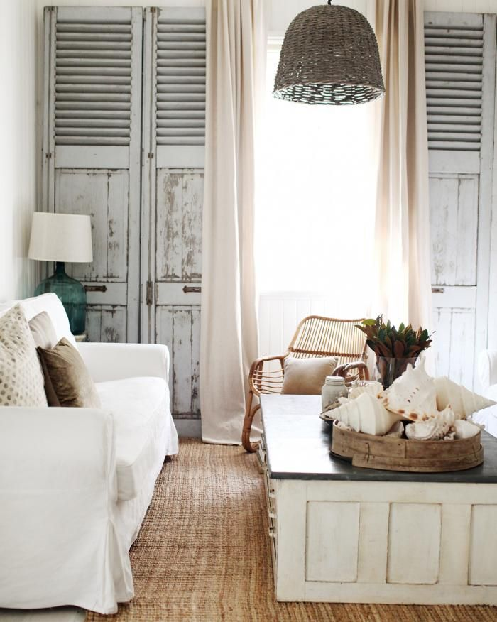 shutters lining wall, large coffee table, neutrals