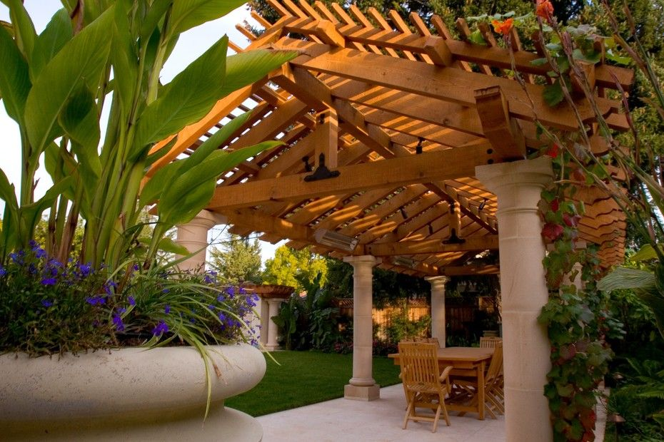Lush and gorgeous covered patio design.  By Pedersen Associates, discovered on porch.com
