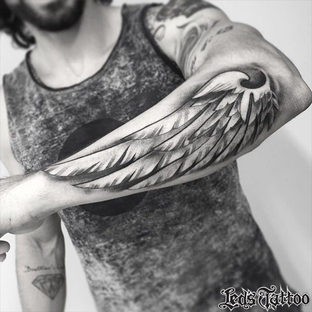 Pin by tattoo blend on tattoos on men pinterest for Wing tattoo arm