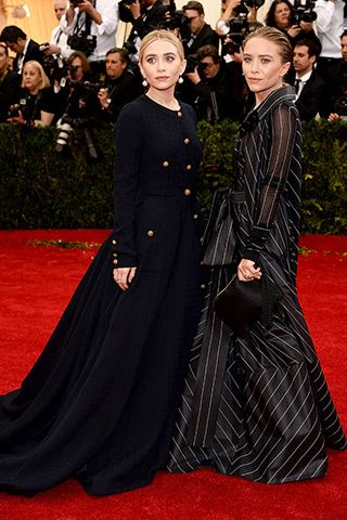 Ashley Olsen, in vintage Chanel, with Sidney Garber jewels, and Mary-Kate Olsen, in vintage Gianfranco Ferré.