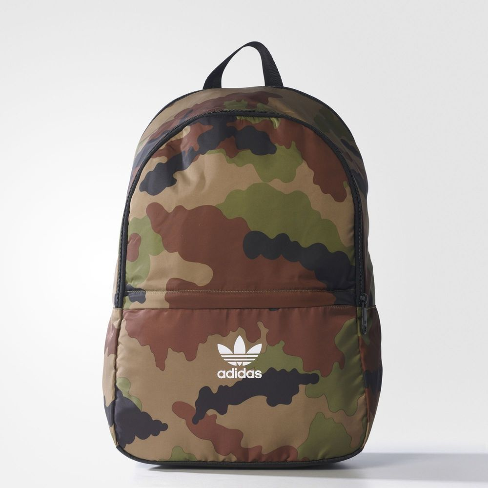 This backpack stands out for all its modern features, even while its  '70s-inspired camo pattern blends in to your world. It has a padded  compartment and ...
