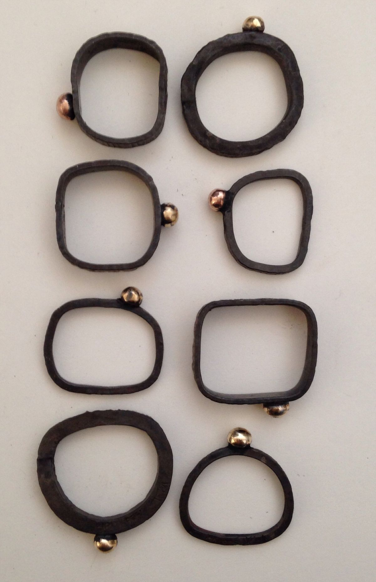 Heidi Abrahamson Rings Oxidized sterling, 14kt yellow & rose gold.