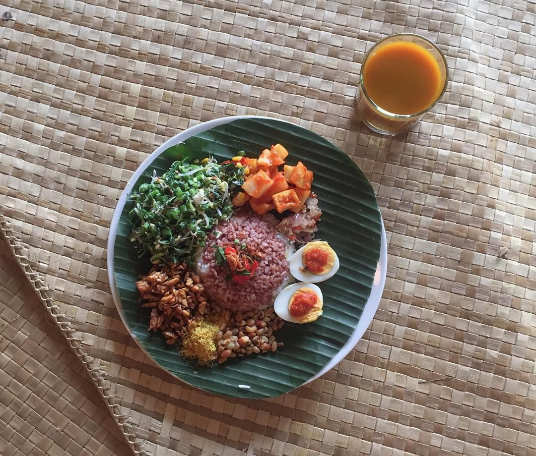 Vegetarian nasi campur and a glass of jamu two of my bali vegetarian nasi campur and a glass of jamu two of my bali favourites at the beautiful yellow flower cafe ubud is truly a conscious eaters paradise mightylinksfo