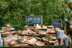 24 Unconventional Wedding Foods Your Guests Will Obsess Over, crostini station, buffet italian style, great idea for event, catering, urban, wood, chalkboard signs, garden, outside, idee für hochzeit, bar, büffet
