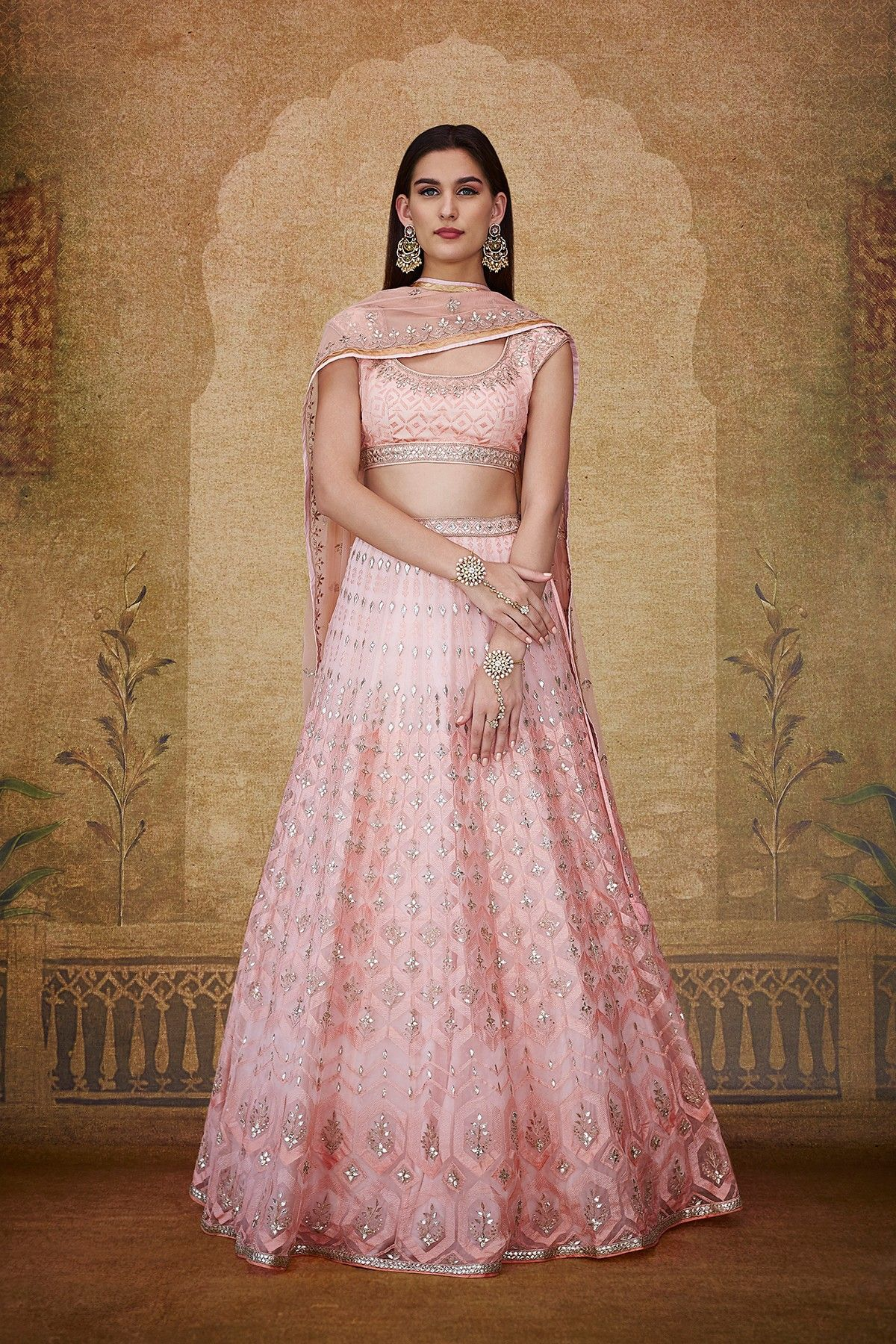 d9cbb04f61 A blush organza choli paired with a blush organza lehenga, styled with a  blush net dupatta, exquisitely embroidered with gota patti, tikki, resham,  pearl, ...