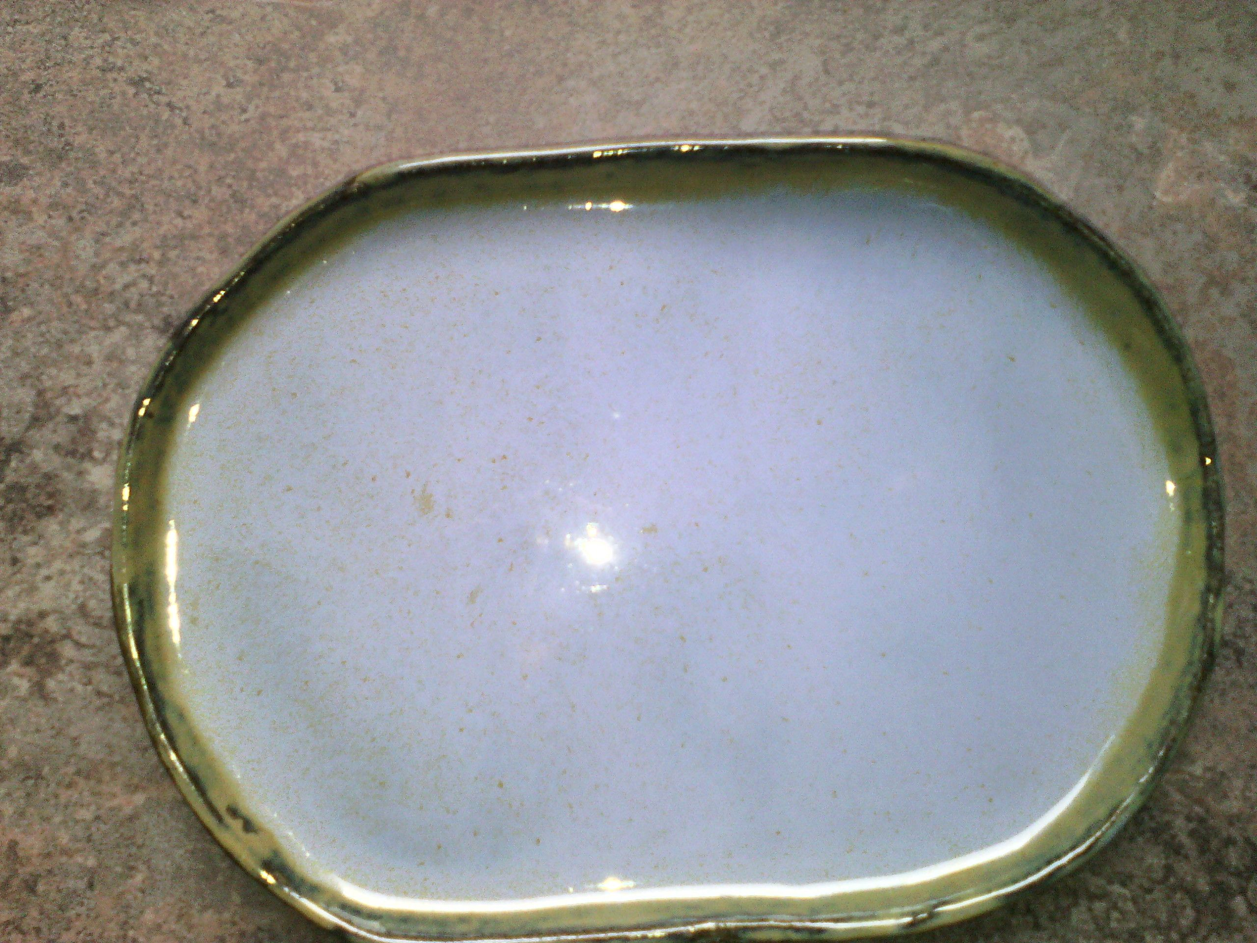 blue/green glaze on white clay