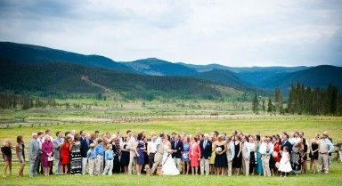 Big group photo with a view at Devil's Thumb Ranch, Colorado. | From the Hip Photo | #wedding #weddingphotos #photographer