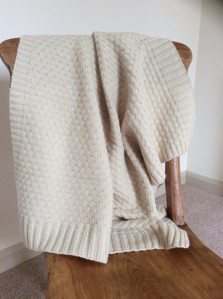So much fun to knit and designed to use up every last yard of this sensationally cosy yarn, this blanket is a must-have treasure for every new baby and toddler. I chose to knit this in a classic natural cream color, but the shade card of this yarn is pretty and the design would work equally well in baby pastels or a more serviceable earth tone for the toddler car seat requirement.
