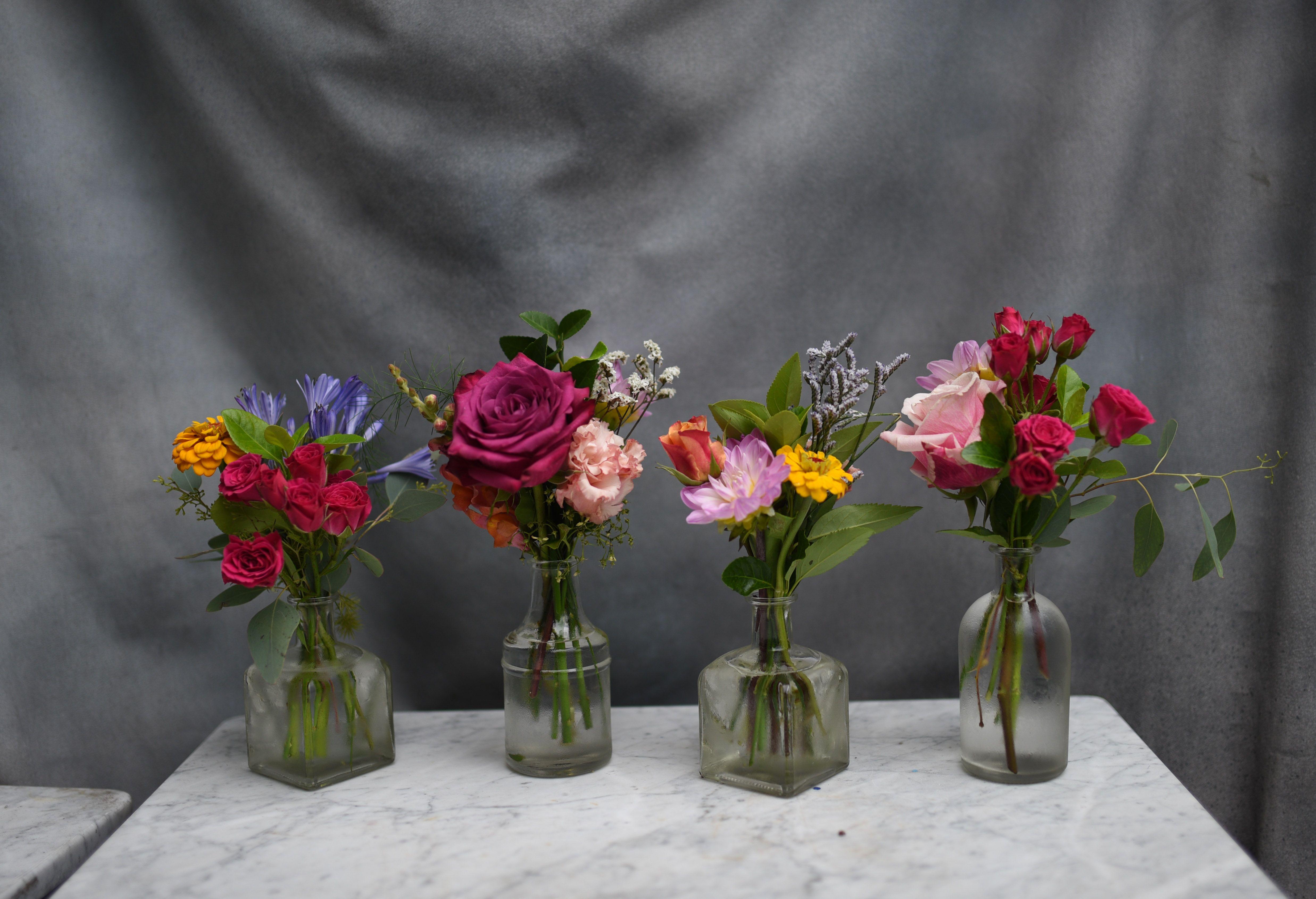 Colorful Mini Bud Vase Arrangement In Small Clear Bottles Roses Spray Roses Dahlias Rosehip Social Florist Bud Vases Arrangements Bud Vases Spray Roses