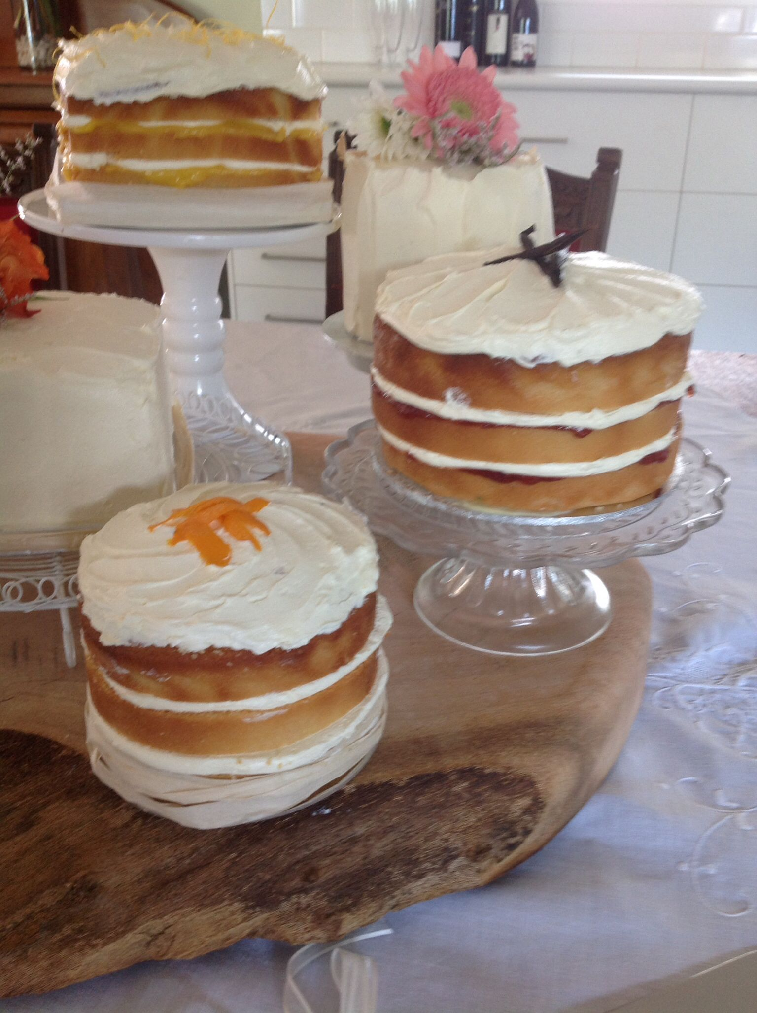 Collection if fruit flavoured rustic cakes for a wedding