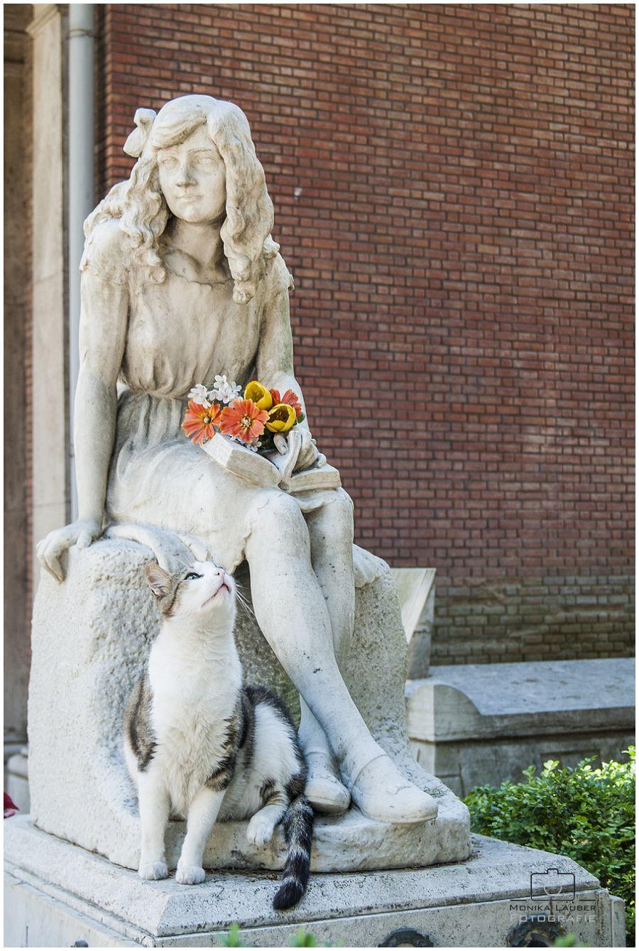 Girl and Cat, Photo by Monika Lauber Location: Cimitero Comunale Monumentale Campo Verano, Rome, Italy