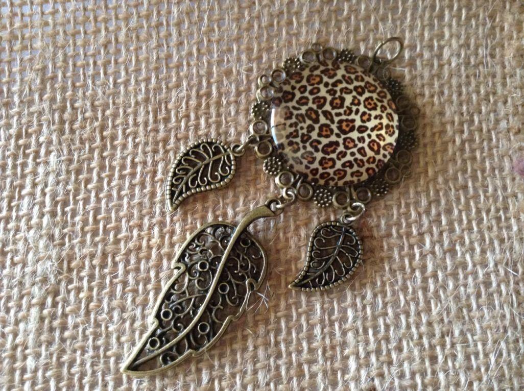 PENDENTIF/BRELOQUE MOTIF LEOPARD COULEUR BRONZE : Autres accessoires bijoux par…