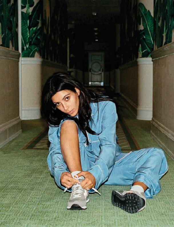 80efd7a706e8 Kim Kardashian wearing New Balance sneakers.