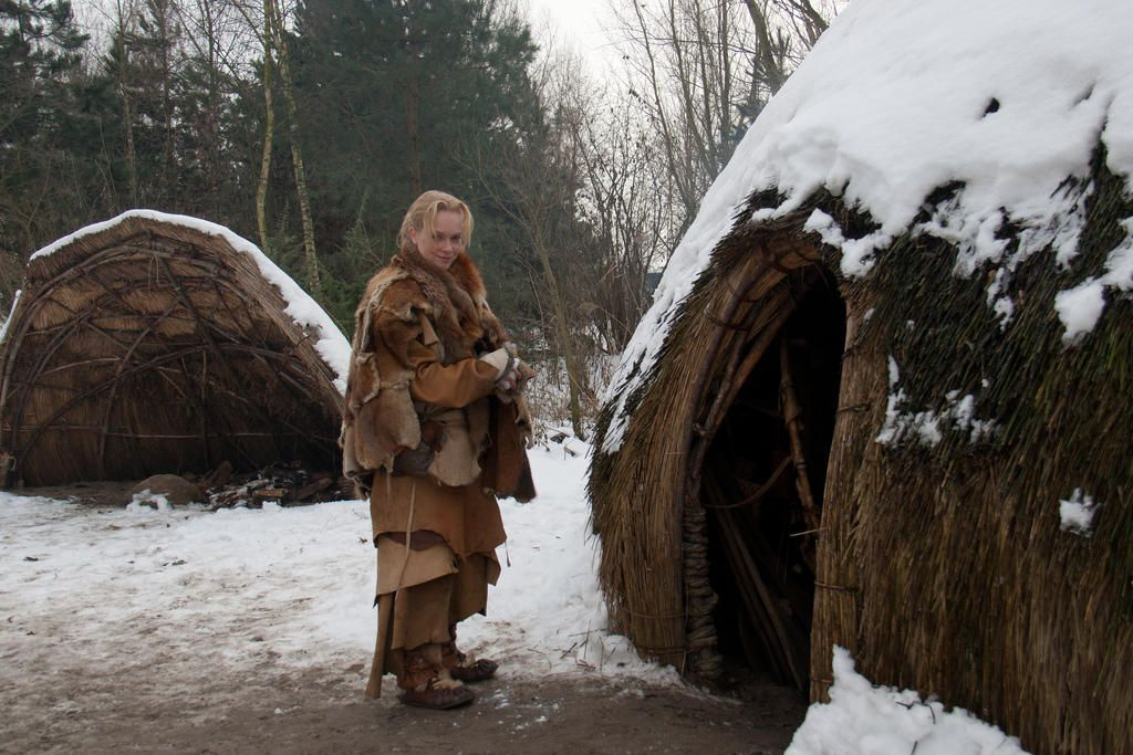 Reconstructed Mesolithic huts in Winter snow Pravěk