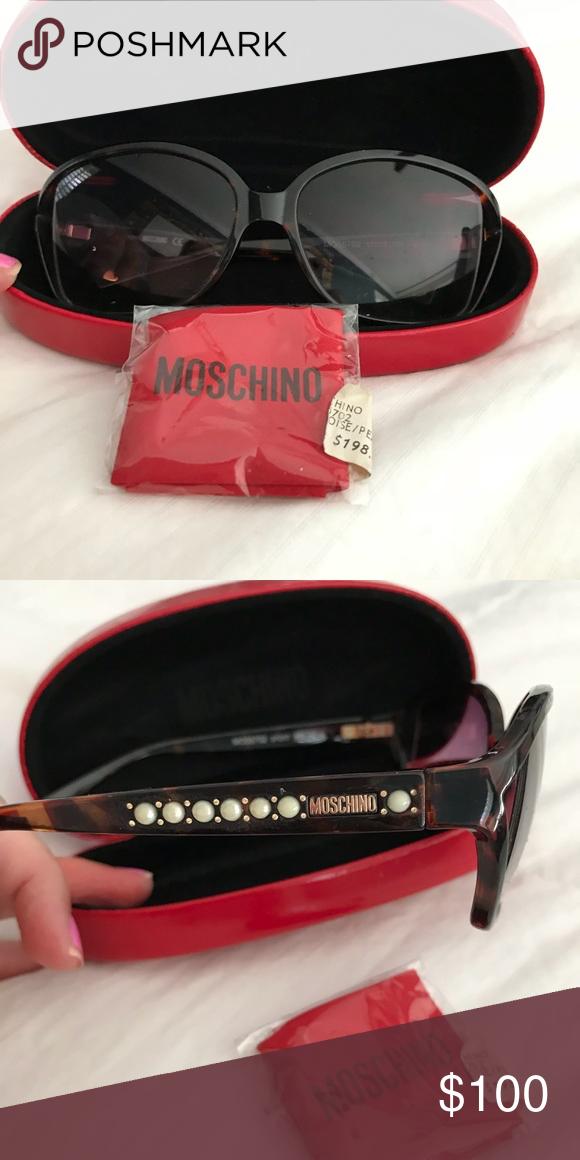 85042658cca MOSCHINO sunglasses Oversized tortashell dark lenses. White small pearls on  side. Moschino Accessories Sunglasses