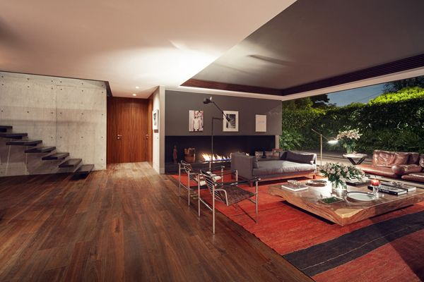 Casa sierra leona a mexico city tribute to modernism glass walls and well manicured lawn create a sleek extension to this living room
