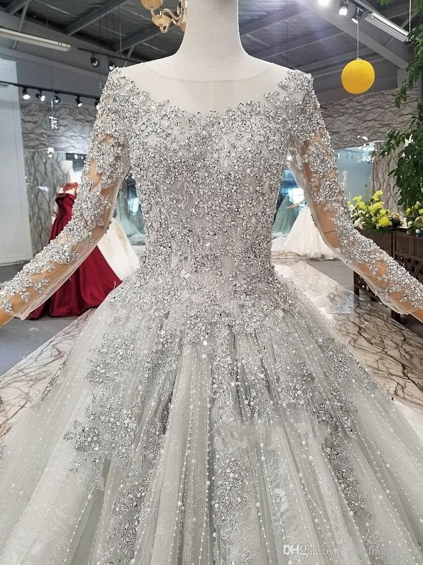 New Fashion Stunning Long Sleeve Beaded Wedding Dresses 2019 Lace Up Sequins Bridal Gowns Bride Wedding Gowns From Weddingpalace 202 77 Dhgate Com Wedding Dresses Beaded Beaded Wedding Gowns Ball Gowns Wedding [ 1133 x 850 Pixel ]