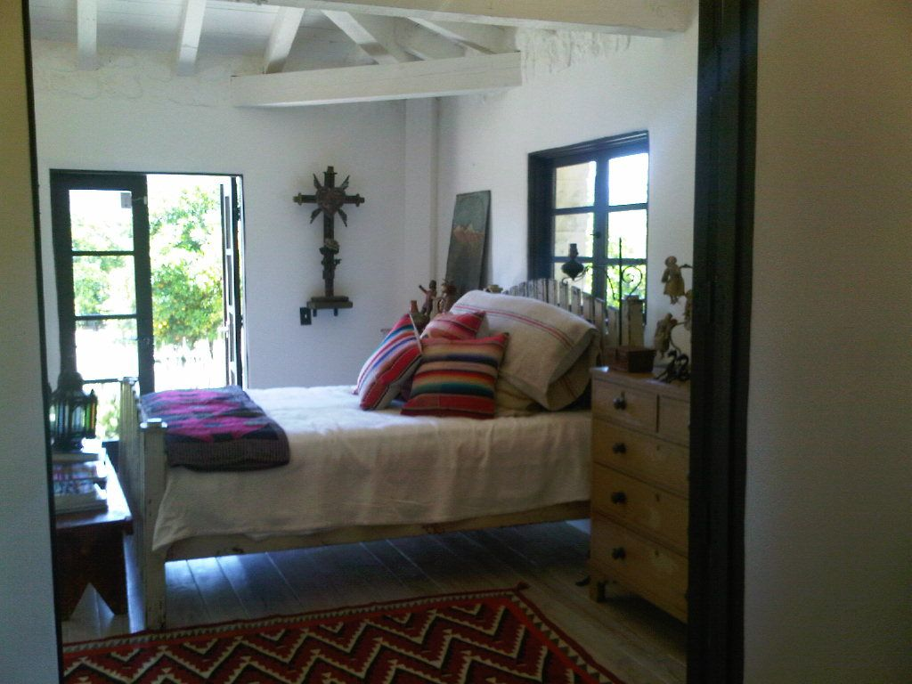 spanish revival bedroom note rug placement, minimal ...