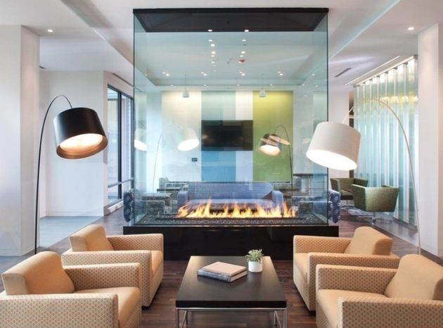 Fireplaces As Room Dividers 15 Double Sided Design Ideas Contemporary Fireplace Fireplace Design Modern Fireplace