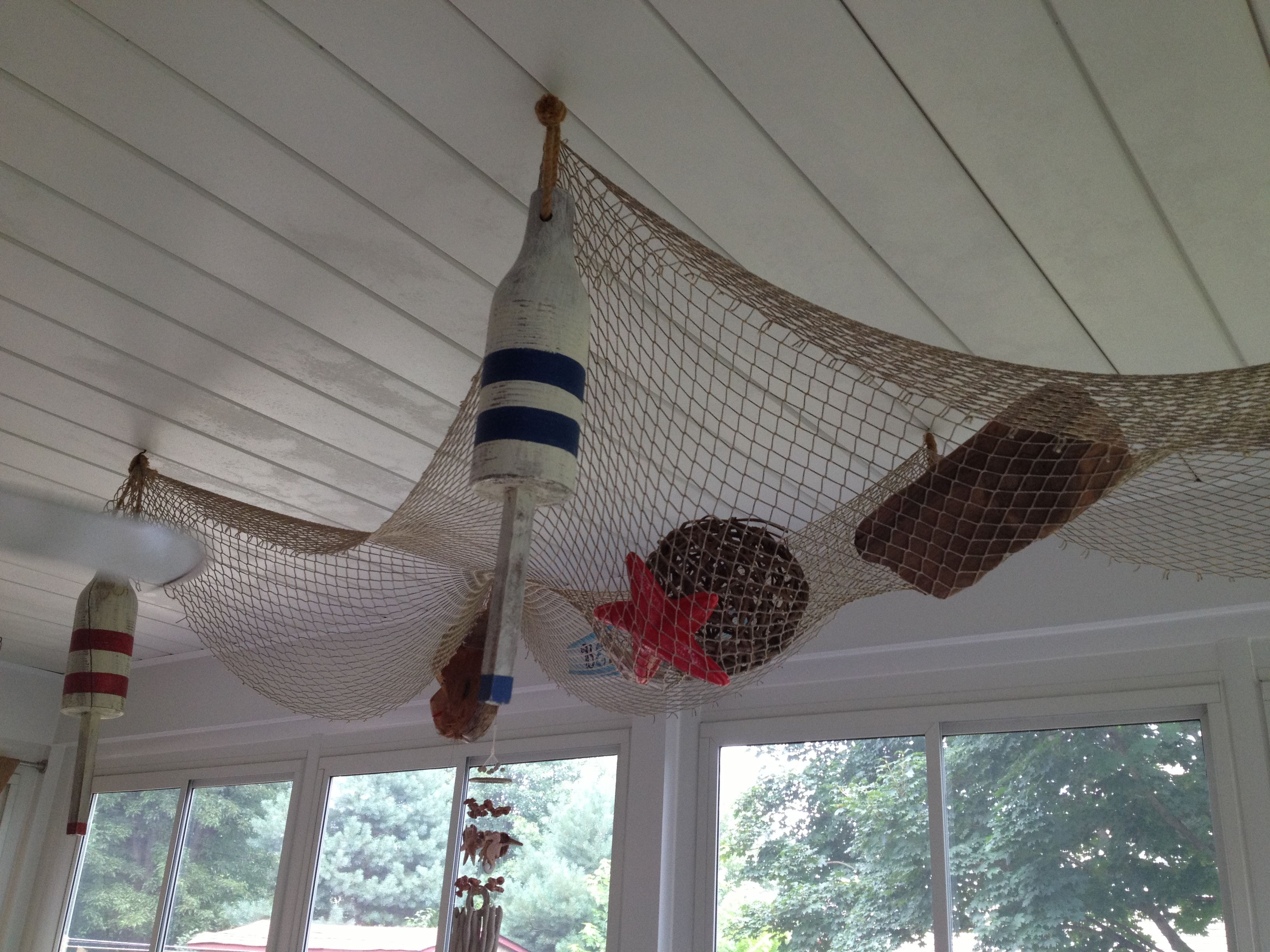 324ae9fbb8031 Fish net on ceiling | Beach inspired decor in 2019 | Fish net decor ...