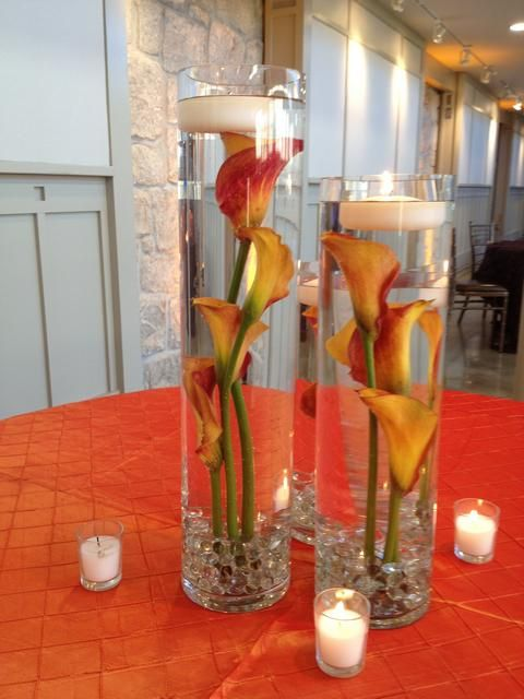 Centerpiece featuring sunken calla lilies inspiration for Orange centerpieces for tables