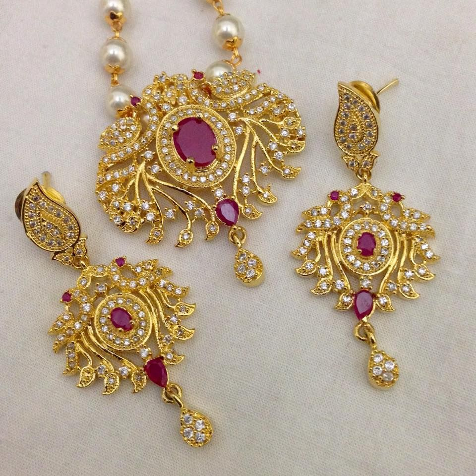 CZ and Ruby pendant with and earrings Code : PS 400 Price: Rps. 1295/- Whatsap to 09581193795 for order processing