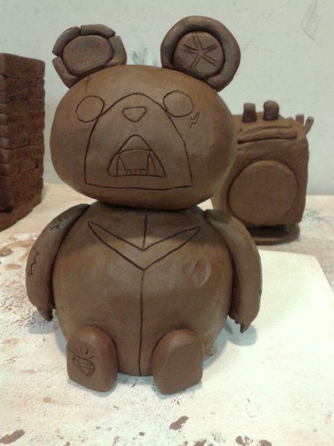 Clay sculpture of a grumpy bear.