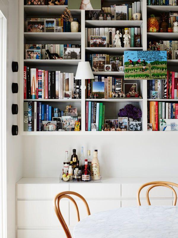 Bookshelf and Drinks Tray. Lights are 'Shady Wall Lamps' by ISM Objects. Painting 'Picking Grapes at Loxton North' by Ian Abdulla. Photo – Annette O'Brien. Production – Lucy Feagins / The Design Files.