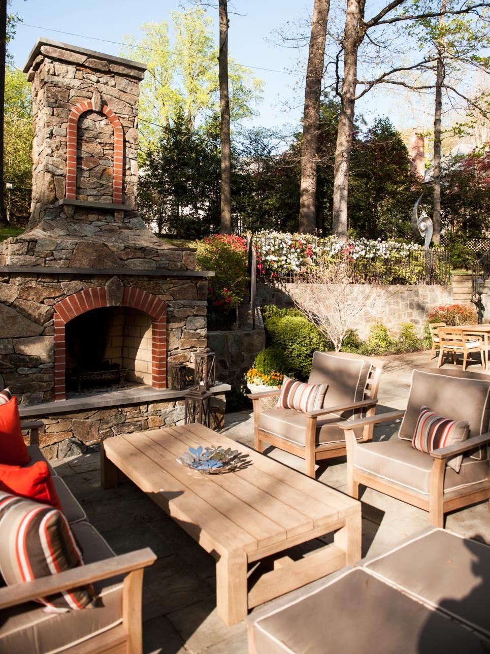 This earthy outdoor area features a large stone fireplace flower