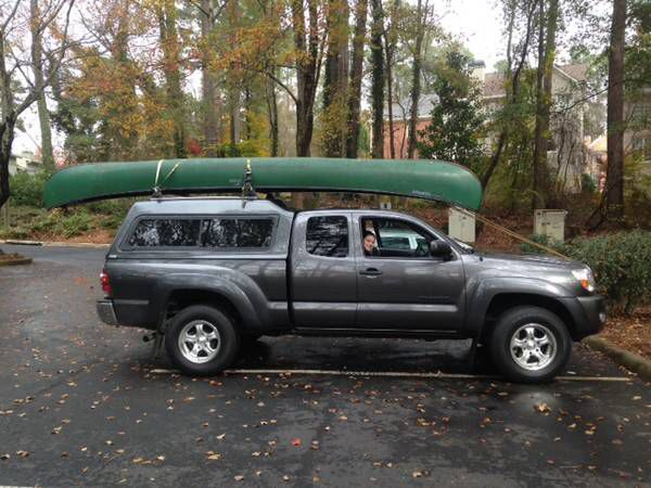 Tacoma Hauling A Canoe With A Canopy Overland Truck Tacoma Truck Toyota Tacoma