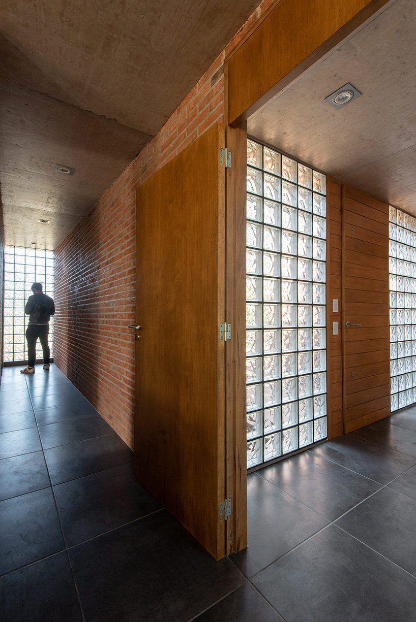 Galera dezeen entrance house brick doors building interior design