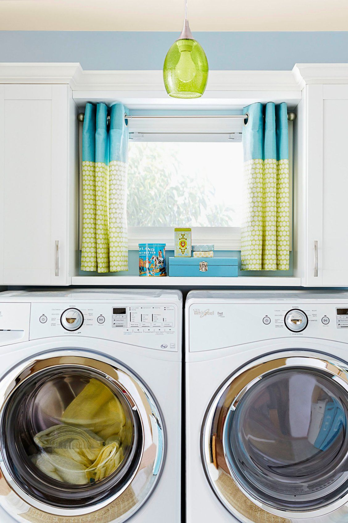 A Side By Side Washer And Dryer Maximize Counter Space Upper Cabinetry Hides Laundry Necessities Home Appliances Hidden Laundry Laundry Room