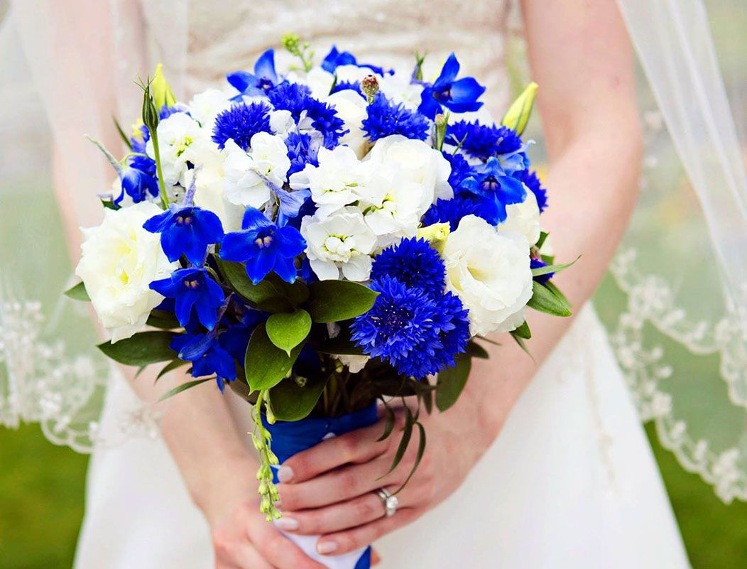 Bride Holding Wedding Bouquet Flowers Stock Delphinium White Roses Lisianthus Cornflower Greenery Israeli And Italian Ruscus