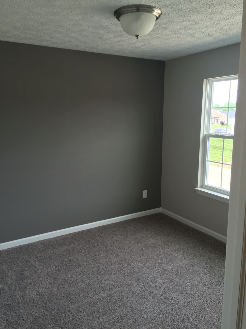 Our carpet is mohawk brand in rainswept gray the dark gray accent wall is done