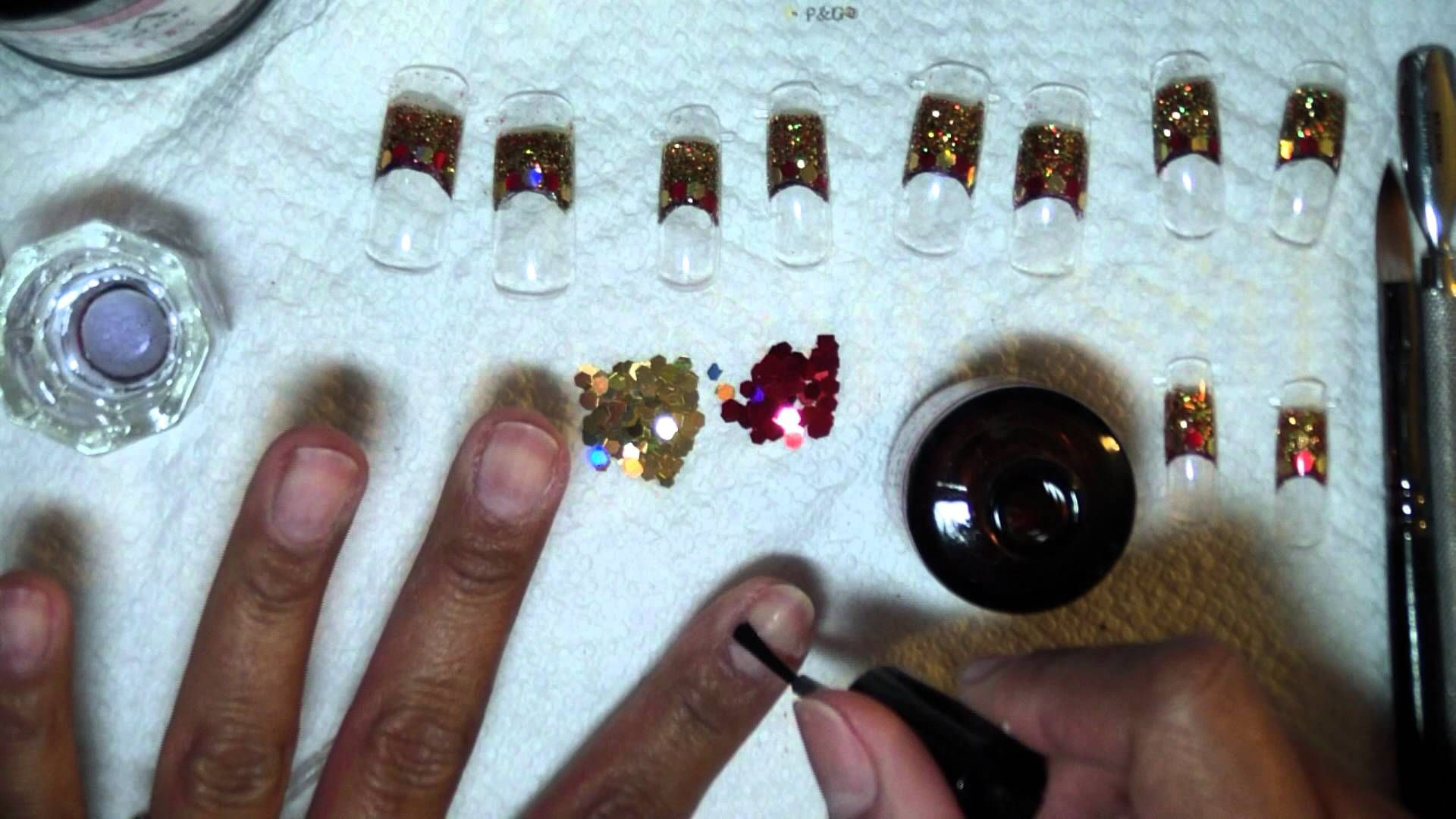Acrylic nail design using dual forms lots of glitter and